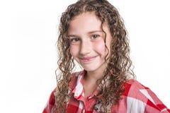Retrato de 9 anos de menina idosa com cabelo encaracolado, isolado no branco Fotografia de Stock