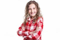 Retrato de 9 anos de menina idosa com cabelo encaracolado, isolado no branco Fotos de Stock