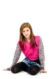 Retrato de assento da forma da menina bonita nova Foto de Stock Royalty Free