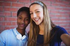 Retrato de colegialas felices Imagen de archivo