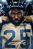 Retrato de Colse-up do jogador de futebol americano no estádio com luzes no fundo Fotos de Stock Royalty Free