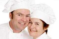 Retrato de dois cozinheiros chefe imagem de stock royalty free