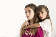 Retrato de dois 15 e irmãs da criança de 10 anos Fotografia de Stock