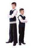 Retrato de dos hermanos en uniforme escolar Fotografía de archivo libre de regalías