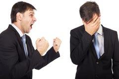 Retrato de dos hombres de negocios que tienen una confrontación Imágenes de archivo libres de regalías