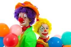 Retrato de duas crianças vestidas como palhaços Fotografia de Stock