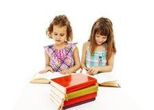 Retrato de duas meninas diligentes no local de trabalho fotografia de stock royalty free