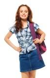 Muchacha con la mochila de la sonrisa y el llevar Imágenes de archivo libres de regalías