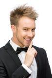 Retrato de gesticular do silêncio do homem de negócios Imagem de Stock Royalty Free