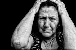 Retrato de Grunge de una vieja mujer tensionada Fotos de archivo libres de regalías