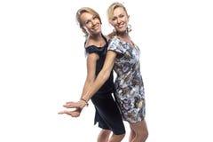 Retrato de irmãs felizes no fundo branco Fotos de Stock
