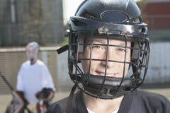 Retrato de jogadores da bola do hóquei com vara de hóquei Imagens de Stock