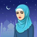Retrato de la animación de la mujer musulmán en un hijab Fotos de archivo