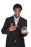 Retrato de la caja de Showing His Money del hombre de negocios Foto de archivo libre de regalías