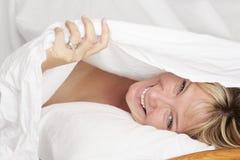 Retrato de la cama Fotos de archivo