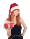 Retrato de la chica joven con el sombrero de la Navidad imagenes de archivo