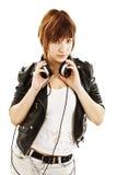 Retrato de la chica joven con los auriculares Imágenes de archivo libres de regalías
