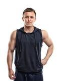 Retrato de la cintura-para arriba del hombre joven musculoso hermoso que presenta para la cámara Imagen de archivo