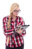 Retrato de la colegiala atractiva en lentes con la carpeta en h Fotografía de archivo