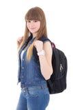 Retrato de la colegiala linda con la mochila aislada en blanco Imagen de archivo