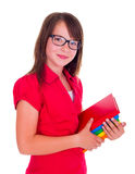 Retrato de la colegiala sonriente que sostiene los libros Fotografía de archivo