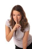 Retrato de la empresaria con el dedo en los labios Imagen de archivo