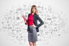 Retrato de la empresaria joven con la carpeta roja Fotografía de archivo libre de regalías