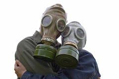 Retrato de la familia en gas-máscaras Imágenes de archivo libres de regalías