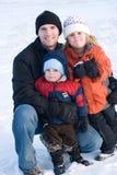 Retrato de la familia en la nieve Fotografía de archivo libre de regalías