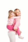 Retrato de la madre y de la hija de abarcamiento felices Fotografía de archivo libre de regalías