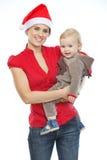 Retrato de la madre y del bebé que celebran la Navidad Imagen de archivo libre de regalías