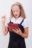 Retrato de la muchacha adolescente con la calculadora en blanco Fotos de archivo