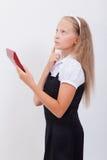 Retrato de la muchacha adolescente con la calculadora en blanco Imágenes de archivo libres de regalías