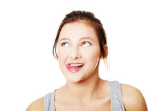 Retrato de la muchacha adolescente que se lame los labios Imagen de archivo libre de regalías