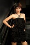 Retrato de la muchacha asiática en oscuro Fotos de archivo libres de regalías