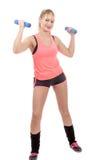 Retrato de la muchacha bastante deportiva que lleva a cabo el peso Fotografía de archivo