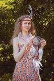 Retrato de la muchacha con Dreamctahcer Fotos de archivo