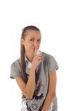 Retrato de la muchacha con el dedo en los labios (aislados) Foto de archivo