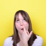 Retrato de la muchacha con el finger en su nariz Fotografía de archivo