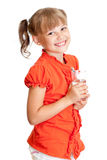 Retrato de la muchacha de la escuela con el vidrio de agua aislado Imagen de archivo