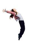 Retrato de la muchacha de salto joven en mid-air imagen de archivo