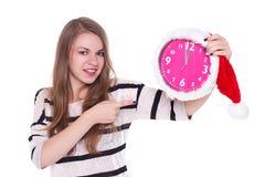 Retrato de la muchacha de santa con el reloj Fondo blanco Foto de archivo libre de regalías