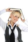 Retrato de la muchacha del blondie con el libro Foto de archivo libre de regalías