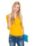 Retrato de la muchacha del estudiante con el libro y los vidrios Fotografía de archivo libre de regalías