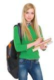 Retrato de la muchacha del estudiante con la mochila Foto de archivo libre de regalías