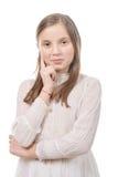 Retrato de la muchacha del preadolescente aislado en un fondo blanco Imagen de archivo