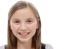 Retrato de la muchacha del preadolescente aislado en un fondo blanco Imagen de archivo libre de regalías