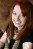 Retrato de la muchacha del redhead en luz natural Foto de archivo libre de regalías