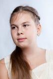 Retrato de la muchacha en la alineada blanca Imagen de archivo