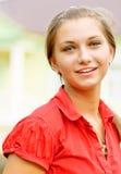 Retrato de la muchacha en rojo imagen de archivo libre de regalías
